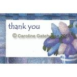 "Pack of 6 Postcards with the image of a bunch of Lilac Blossom in a blue and white vase to the right of the card. The card has a wide border in various blue tones to match the Lilac. There is a blank area in the middle for a message, and the words ""Thank You"" at the top"
